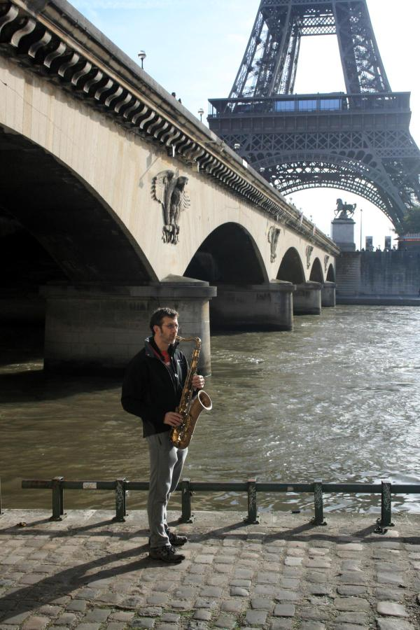 Playing Sax by the Seine
